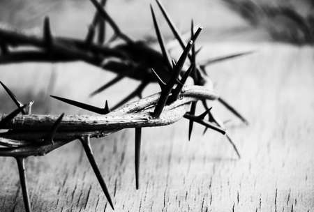 Crown of thorns on wood desk. Christian concept Archivio Fotografico