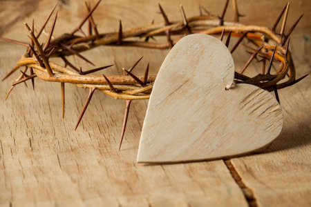 Crown of thorns on wood desk. Christian concept Stock Photo