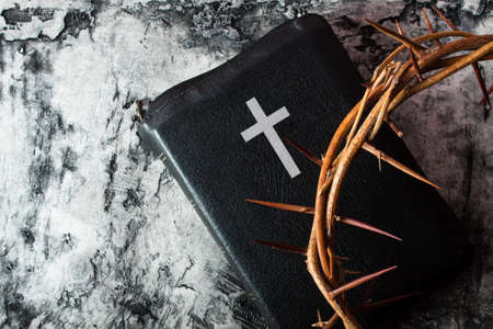 Crown of thorns and Bible on wood desk. Christian concept Фото со стока