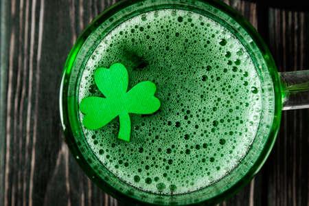 Happy St. Patricks Day green drink on wood desk