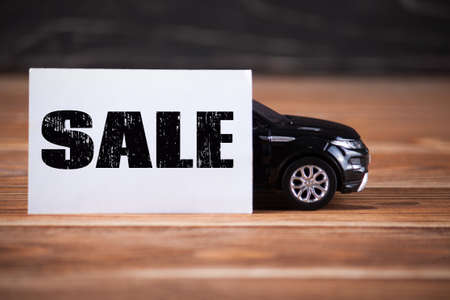 Toy car on the wood boards. Used cars Stock Photo