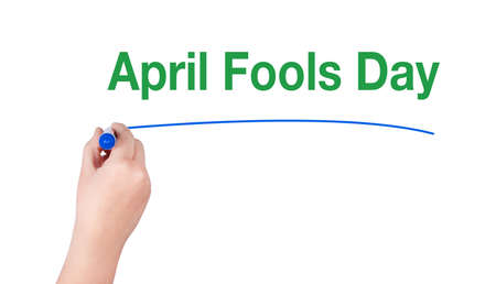 idiot box: April fools day word write on white background by woman hand holding highlighter pen