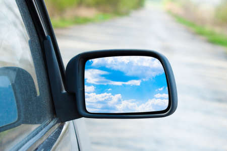 Rearview mirror close up on nature. Landscape Stock Photo