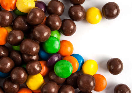 Multicolored candy on a white background. Glazed pills.