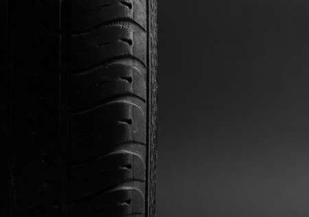 winter tires: Car tire isolated on black background. Objects isolated Stock Photo