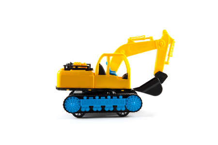 Excavator toy isolated on white background. Building concept Stock Photo