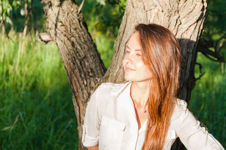 Young woman outdoors portrait. Soft sunny colors.