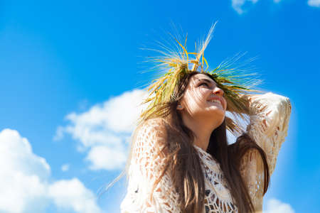 Fashion beautiful girl in the field with yellow spikelets on the sky background Stock Photo