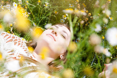 free education: Fashion beautiful girl in the field with bouquet of wildflowers Stock Photo