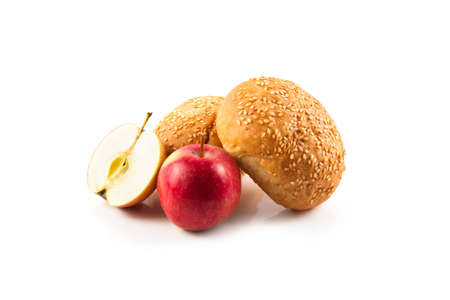 Symbols of the Jewish New Year. Apple, honey, Shofar, challah isolated on white background Stock Photo
