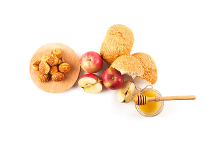 Symbols of the Jewish New Year. Apple, honey, Shofar, challah isolated on white background Stock Photo