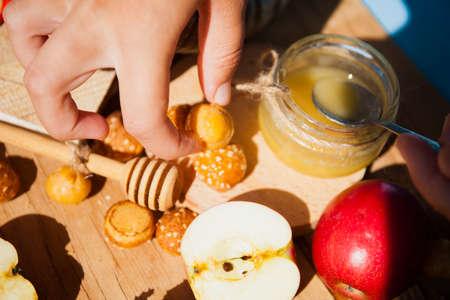 Symbols of the Jewish New Year. Apple, honey, Shofar, challah close up.