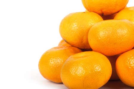 Fresh ripe tangerine isolated on white background