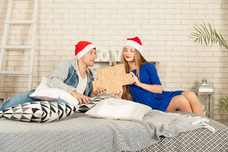 couple in love waiting for Christmas. Shooting in studio