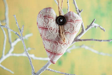 Heart from cloth on wood background. Happy Valentines day