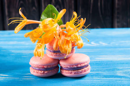 Colored macaroons on wood desk. Baking. food ingredients Stock Photo