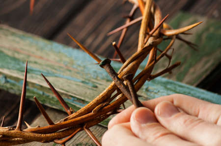 Crown of thorns on wood desk. Christian concept. Easter Jesus