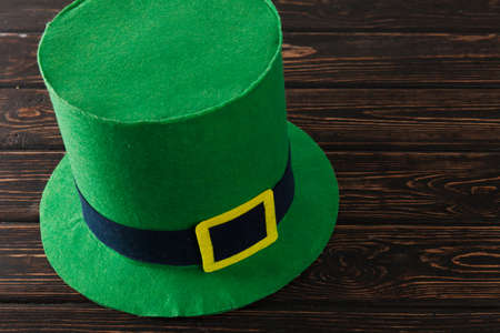 Save the date white block calendar for St Patrick's Day with Leprechaun on wood desk
