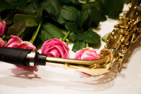 Saxophone with roses close up. Mothers day. Greeting card