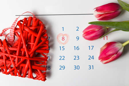 Calendar with a red circle around the number 8. Happy womans day