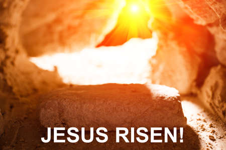 The stone is rolled away from the grave on Easter morning. Jesus risen Stock Photo