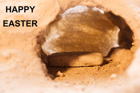 The stone is rolled away from the grave on Easter morning. Jesus risen