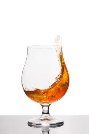 cognac in wineglass isolated on white background. Alcohol drink