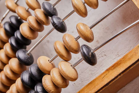 Vintage abacus on wooden background. Business concept Фото со стока