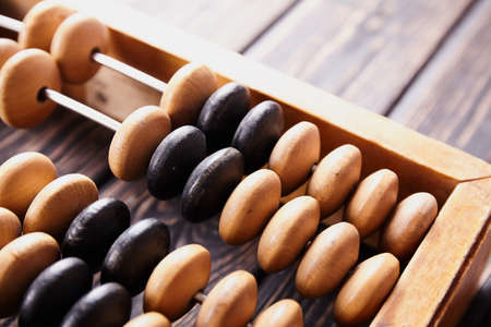 Vintage abacus on wooden background. Business concept Stock fotó