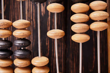 Vintage abacus on wooden background. Business concept Stock Photo