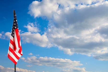 American flag on blue sky. Nature background 免版税图像