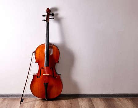 Old cello close up. Music stage background. Foto de archivo