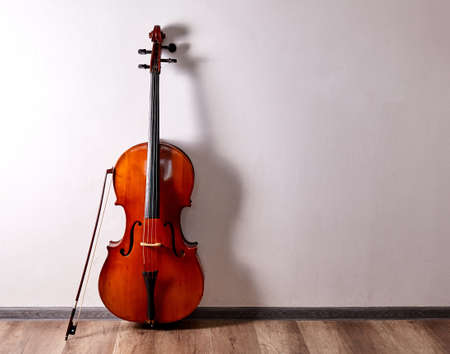 Old cello close up. Music stage background. Banco de Imagens
