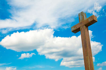 Cross on blue sky outdoor. Nature objects. Religion concept Stock Photo