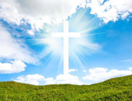 Cross on blue sky outdoor. Nature objects. Religion concept Standard-Bild