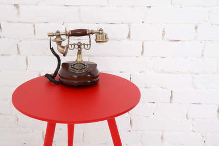 Old retro phone in interior. Vintage style