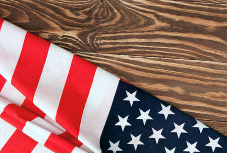 American flag close up on wood desk. Veterans day