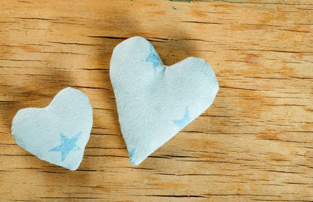 heart made of cloth on wooden background