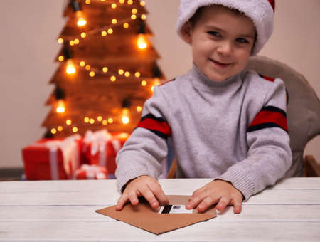 Little boy gets credit card from letter to Santa claus