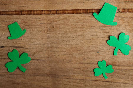 Happy St Patricks Day tag with corner border of shiny shamrocks over a rustic wood background. Place for text Stock fotó