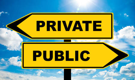 Private or Public - Traffic sign with two options - services and companies owned by state or private businessman. Socialist  Capitalist question of privatization, school system, health service Banco de Imagens