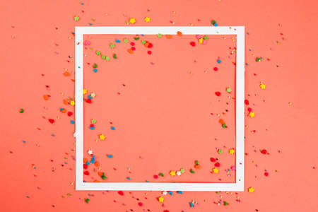 White frame on coral background. Creative layout. Top view Stock Photo