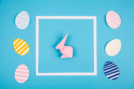 Creative layout for easter day with rabbit and color eggs