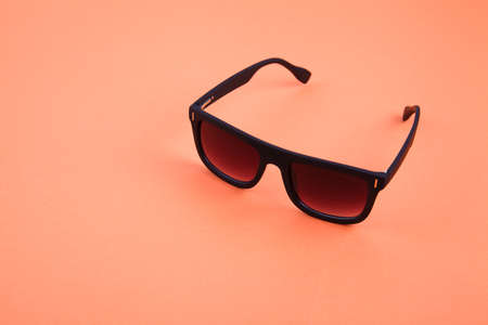Sunglasses on color background. Place for text. Template for design