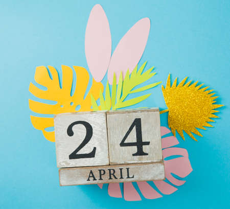 Calendar cube with date 24 april. Easter background