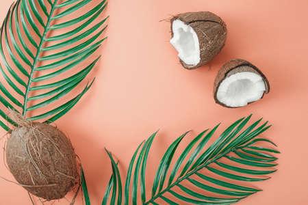 Fresh coconut on coral background. Food ingredients. Health food Imagens