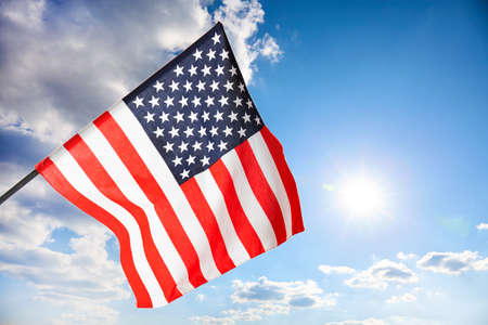 Air clouds in the blue sky with american flag Imagens