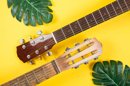 Part of Acoustic guitar resting on color background with copy space. Modern concept