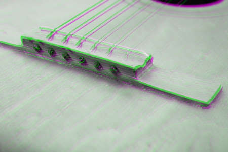 Glitch effect. Acoustic guitar resting on color background with copy space. Modern concept