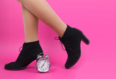 Legs of young caucasian woman in black tights on pink background Archivio Fotografico - 129736269